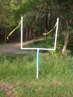 """Check out my DIY goal posts. Super simple. I used 4ft sections of 1 1/2"""" PVC pipe and a few pipe fittings to create a football field for my son's b-day party. I used yellow surveyor's tape tucked under the pipe caps for the top streamers and a pool noodle cut in half for the lower padding. I hammered a metal """"T"""" post into the ground and the pipe fit right over it to stand the goal up. No glue needed and so they can be easily taken apart and stored!"""