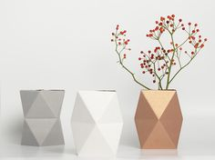 Make simple flowers special with an offbeat vase.  Rose gold/bronzy vase with red and green - color palette.