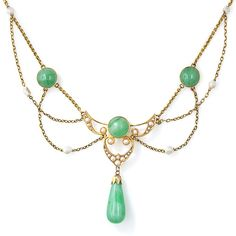 Art Nouveau festooned necklace, c1901.  Features both jade and natural freshwater pearls set in 14 karat yellow gold. A tear drop polished jade drops from the center. Krementz hallmark.