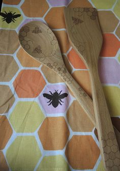 """This cheerful Bee and Honeycomb dish towel from 1Canoe2 looks beautiful hanging on a crisp white oven or even framed as an accent in your kitchen. A perfect hostess gift or accent for your own kitchen! 19x22"""" Cotton with hanging strap on the back. Mixing Spoon and Turner SoldSeparatelyHERE"""