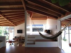 Asymmetrical (and slanted) ceiling beams and a very open space