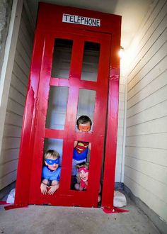 "Super hero party! - telephone booth for front door.  Call your local Home Depot/Lowes and ask for a refrigerator box.  Box should be broken down- cut one panel off (you only need 3 sides).  Next, cut the door and establish a ""hinge"" crease (those boxes are extremely thick...and you'll kick yourself if you don't do this first).  Next cut the windows.  To add height, I rigged the top of the box (flaps) to stand up and taped on a new top. Line the windows with electric tape."