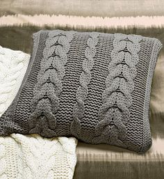 The Oversize Cable-Knit Pillow and Throw are made with wool and up-cycled acrylic –– Spring-Clean Your Decor With Sustainable Switcheroos