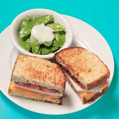 Grilled Cheese with Turkey and Tomato Ingredients 2 slices whole-grain bread 1 slice cheddar cheese 2 ounces sliced turkey 1 slice tomato Cooking spray 1/2 cup pea pods 2 tablespoons low-fat ranch dressing Make It Make sandwich with bread, cheese, turkey, and tomato. Coat a skillet with cooking spray and toast sandwich for about 3 minutes on each side, until bread is golden brown and cheese is melted. Serve with pea pods and ranch dressing.
