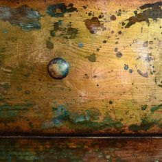 A close up of the drawers. The inspiration behind this dresser was the treasure chests found on the bottom of oceans. The gold leafed…