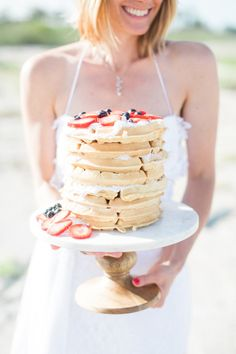 Hosting a sunrise elopement? Opt for a yummy waffle cake! http://www.stylemepretty.com/florida-weddings/2015/09/28/seaside-sunrise-boho-elopement | Photography: Hunter Ryan Photo - http://hunterryanphoto.com/