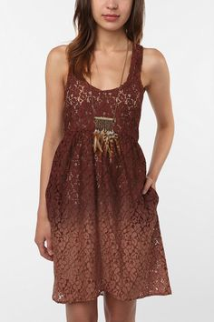 $79 An adorable vintage dress with a unique brown lace design. Bring it on, fall.