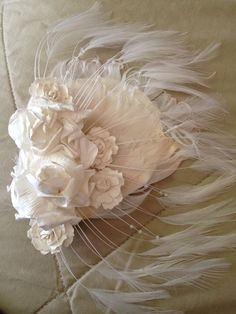 My favorite. I made this for court when I got legally married. Simple ,romantic nd sweet.  Feathers , flowers a hair clip nd put it all together. Rapped the inside of the hair clip with ribbon.  Hot glue will always be ur best friend lol