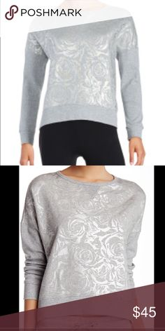 """Betsey Johnson Rose Foil Sweatshirt Metallic silver flowers are printed allover a knit dolamn top with ribbed contrast and a crew neck. - Crew neck - Long sleeves - Hi-lo hem - Approx. 20"""" front length, 24"""" back length Betsey Johnson Tops Sweatshirts & Hoodies"""