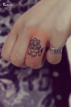 Little lion tattoo. Cartoon-ish. Stick and poke tattoo