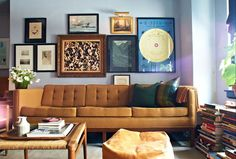 Vintage sofa, gallery wall, stacks of books. I could live here...