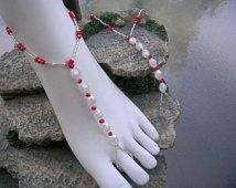 Red and white bare foot sandals.