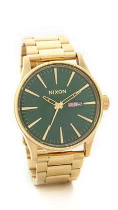 green and gold Nixon watch http://rstyle.me/n/q8e2mr9te