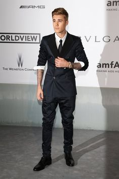 Pin for Later: Stars Dress Up and Do Good at the amfAR Gala in Cannes  Justin Bieber walked the carpet at the amfAR Gala.