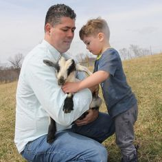 Father  Son. It makes my heart swell to see these two together.  My son loved the goats. I still think we need one even in the city because our yard is composed of all weeds so a goat could be pretty helpful. That's how I'm trying to convince my husband.
