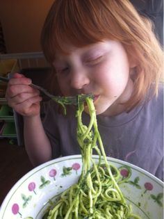 I'm making this tonight with the vegetti Jess got me. Look at this kid's face! : Zucchini Pasta with Creamy Basil Avocado Sauce