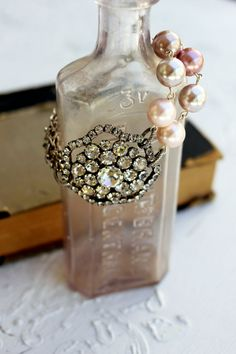 vintage inspired rhinestone bracelet.  Love the large size pearls.