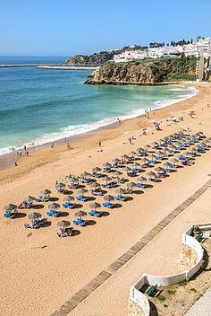 Fisherman beach, Umbrellas and beach chairs, Albufeira, Algarve, Portugal.
