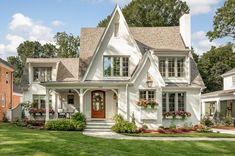 Named the Fairytale Cottage by luxury home builder Gerrard Builders, this perfect white painted-brick home definitely has us dreaming. The beautiful blend of modern and traditional styles create an inviting place that feels timeless. Brick Cottage, White Cottage, Cottage Homes, Tudor Cottage, English Cottage Exterior, English Tudor Homes, Cottage House Plans, Cottage Ideas, Cozy Cottage
