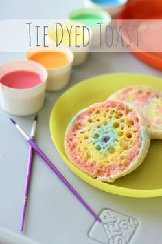 Tie Dyed Toast: color milk with food coloring, paint bread then toast! An art project and snack all in one! AD