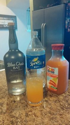 Blue Chair Bay recipe  The Riptide  2 oz coconut spiced rum then pour half a glass of Dole orange strawberry banana juice and half a glass sprite zero over ice