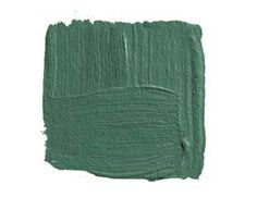 """BENJAMIN MOORE GARDEN CUCUMBER 644: """"To me, cozy is a dark color like this green, with just a trace of blue. It's the color of the green baize door in an old English country house. Cozy needs to be small, intimate, a place where you can curl up with a drink by the fire. Dark, rich colors actually make me feel introspective. Bring in some deep wood tones and a bit of gilt for some sparkle."""" -Michael Whaley"""