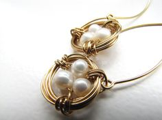Birds nest pearl eggs gold wire wrapped earrings by SunshineJewls on Etsy.  A Vancouver Island Etsy Team Member