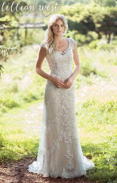This soft charmeuse V-neck slip dress will feel lightweight and effortless. The tulle and Venice lace overlay with cap sleeves completes the style.