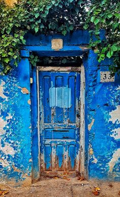 Old blue door in Zaragoza, Aragon, Spain.