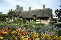 The beautiful gardens at Anne Hathaway's Cottage, the childhood home of William Shakespeare's wife in the village of Shottery, Warwickshire, England