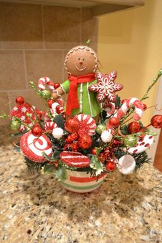 Whimsical Gingerbread Man Arrangement by kristenscreations on Etsy Gingerbread Christmas Decor, Gingerbread Crafts, Gingerbread Decorations, Tabletop Christmas Tree, Christmas Door Decorations, Christmas Arrangements, Whimsical Christmas, Christmas Centerpieces, Christmas Themes