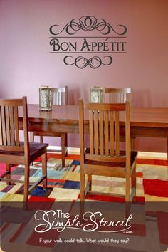 "This contains: Beautiful ""Bon Appetit"" vinyl wall decal installed on a dining room wall with colorful elements. The Bon Appetit sign is shown in black in a large size that works perfectly for the customers color scheme and dark red walls. Includes the flourish design scrolls on top and bottom to give the decal and old world Italian restaurant flair. #restaurantdecor #bonappetitsign #bonappetitdecals #bonappetittattoo #walldecor #diningroomideas #diningroomdesign #wallart #decals #walldecals… Kitchen Wall Quotes, Vinyl Wall Quotes, Vinyl Wall Decals, Dining Room Walls, Dining Room Design, Country Kitchen Designs, Country Kitchens, Cafe Window, Wall Decor"