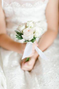 Pretty rose flower girl bouquet: http://www.stylemepretty.com/missouri-weddings/top-of-the-rock/2015/08/31/traditional-elegant-wedding-in-missouri/   Photography: Koman Photography - http://komanphotography.com/