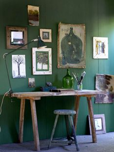 vintage workspace. emerald coloured wall.