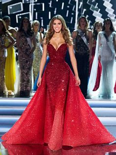 Miss Universe 2016 Iris Mitteneare in a scarlet red ombré couture Michael Cinco Couture gown in full Swarovski crystals on her final walk during Miss Universe 2017 finals in Las Vegas.