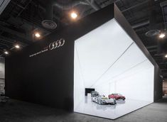 Striking exhibition stand by Audi shows a cone of light with Audi's premium cars