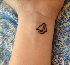 Simple Sailboat - http://www.pairodicetattoos.com/simple-sailboat/