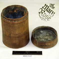Wooden Canister containing Beeswax and Poppy oil. 'This turned wooden canister was found in the surgeon's chest, on the Mary Rose, a Tudor era ship that sunk in 1545. The canister contained a grey powder, which you can still see lining the interior. Examination of this powder shows it was originally beeswax and poppy oil. This was used to treat inflammations of various parts of the body and could also be used as a painkiller'.