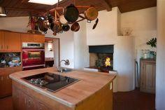 Frank Lloyd Wright's Santa Fe 'Pottery House' Southwest Kitchen, Southwest Style, Red Ovens, Butcher Block Island, Pottery Houses, Adobe House, Frank Lloyd Wright, House Built, Renting A House