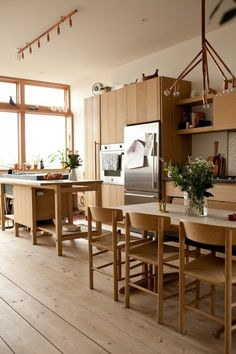 """minimalist kitchen/dining design with all """"kitchen"""" installations on one wall from Dering Hall article"""