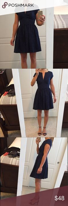NWOT Juicy Couture Navy Fit & Flare Dress, size 0 Gorgeous NWOT navy fit and flare dress with detailing throughout. Cap sleeves and a V cut neckline. Very high quality cotton/polyester dress. Perfect so many occasions! Juicy Couture Dresses Mini