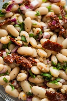 Creamy, punchy and tangy Sun Dried Tomato & Cannellini Bean Salad - make in 15 minutes or less with minimal prep! Serve as a simple side, as a snack or starter with bread or crackers or enjoy as a light lunch or dinner. Chickpea Salad Recipes, Bean Salad Recipes, Vegetarian Recipes, Cooking Recipes, Healthy Recipes, Bean Salads, Vegetarian Sandwiches, Cooking Corn, Going Vegetarian