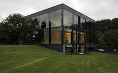 Glass house containing old stone building