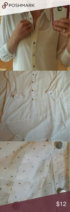 """Sheer Polka Dot Top Cute, loose, button up cream top with raised, silver polka dots. Hi-lo style. Measures 32"""" at the longest point and 26"""" at the shortest. Shoulder to shoulder is 17"""". Bust is 40"""".  Excellent condition. Focus 2000 Tops Button Down Shirts"""