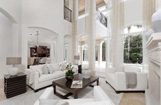 Elegant Transitional Style White living room decor with white sofa and white armchairs, white transitional style ling decor, classic white living room decor