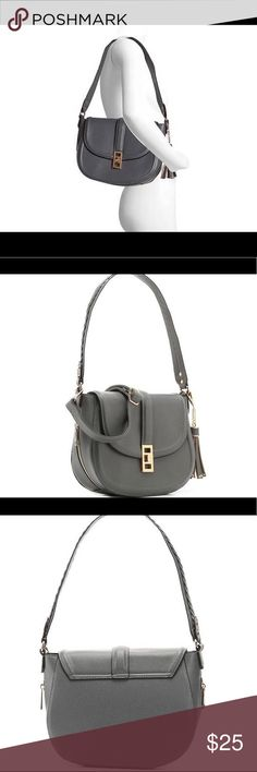 """Melie Bianco Kennedy Crossbody A crossbody shoulder bag with serious style take on the day with the easy and chic Kennedy saddle handbag from Melie Bianco! Faux leather upper Fold over flap with twist lock closure Shoulder strap with 11"""" drop Removable adjustable shoulder strap with up to 25"""" drop Side zip accents and removable tassel bag charm Main zip compartment with fabric lining with interior side zip pocket and 2 slit pockets 13"""" x 4"""" x 9½"""" Imported Melie Bianco Bags Crossbody Bags"""