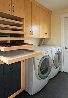 Love the rolling racks to dry clothes flat...