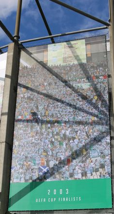 This banner which is being displayed at Celtic Park depicts the year 2001 when over 80,000 Celtic fans travelled to Seville as Celtic became UEFA Cup Finalists. Were you there?