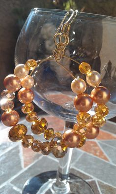 These gold beaded and pearl hoop earrings are 2.75 inches in length.  They are made with topaz 8mm glass beads and 12mm Amber glass beads. 28.