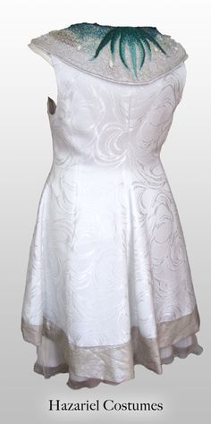 Original and unique wedding dress, handmade with marine enbroidery.